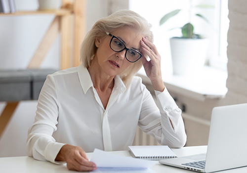 Woman Trying to Focus on The Computer